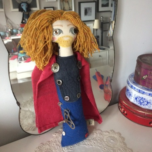 A photo of an art doll of Thor from the Marvel movies
