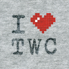 ASCII style image of a red heart on a grey t-shirt background, reading: I heart TWC.