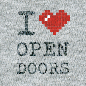 ASCII style image of a red heart on a grey t-shirt background, reading: I heart Open Doors.