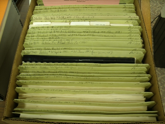 Photo of a box filled with fanzines.